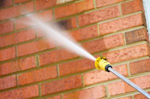 brick wall being pressure washed