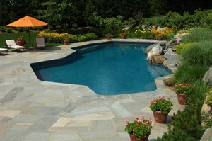 backyard pool with slabstone deck