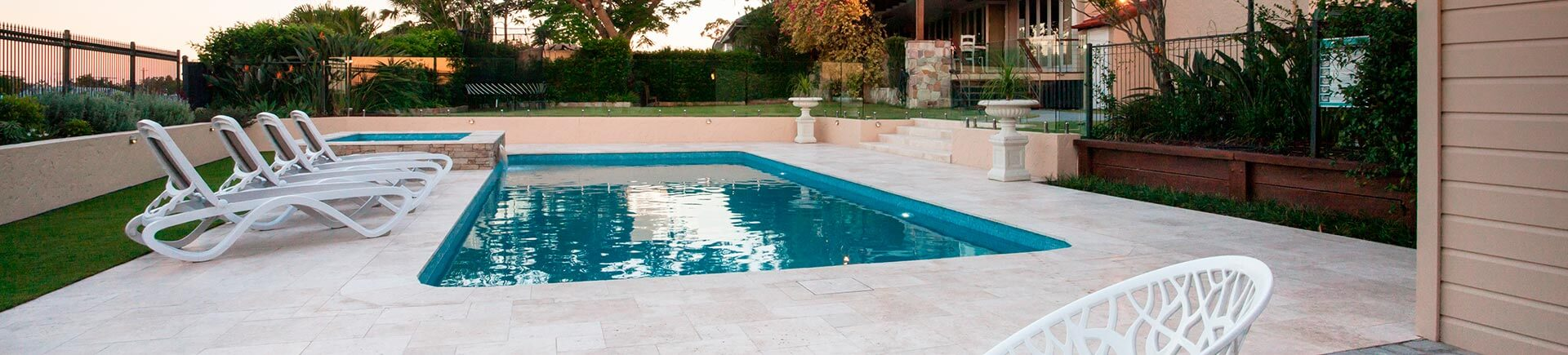 Backyard swimming pool with paver deck after pressure washing